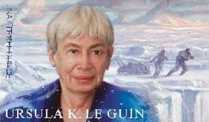 Ursula Leguin postage stamp. Leguin in the foreground. Two figures pull a sledge across a glacier in back