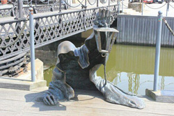 Statue of the Black Ghost that guards a Lithuanian city. Image, Atlas Obscura