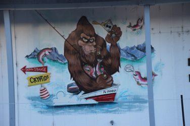 Image, Bigfoot fishing and drinking beer
